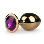 Metalen buttplug met paarse steen - goudkleurig