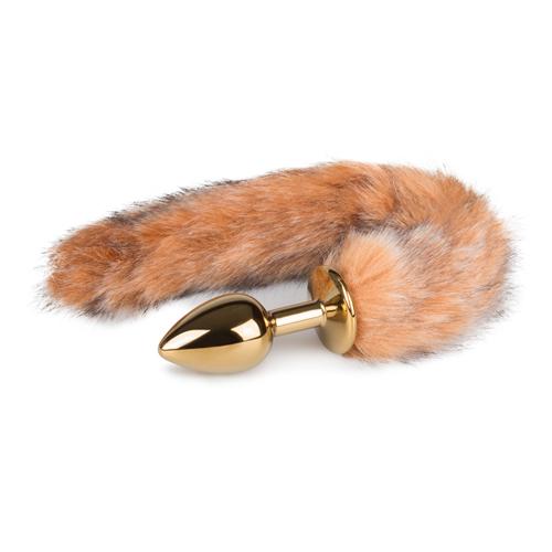 Kleine goudkleurige buttplug met gestreepte vossenstaart