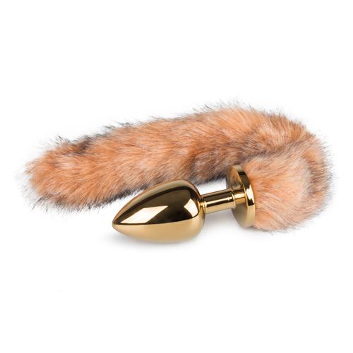 Goudkleurige buttplug met gestreepte vossenstaart
